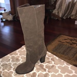 Brown heeled leather boots, never worn